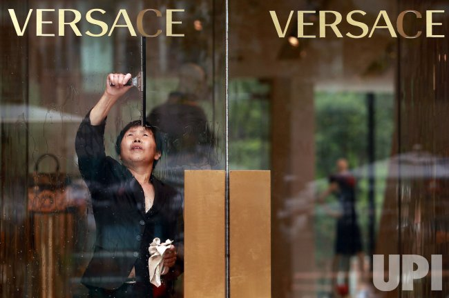 Image result for versace employee