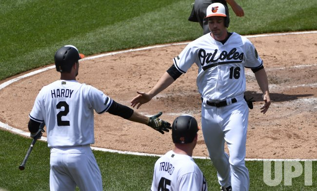 Orioles Trey Mancini congratulated by J.J. Hardy after scoring against Yankeees with Mark Trumbo