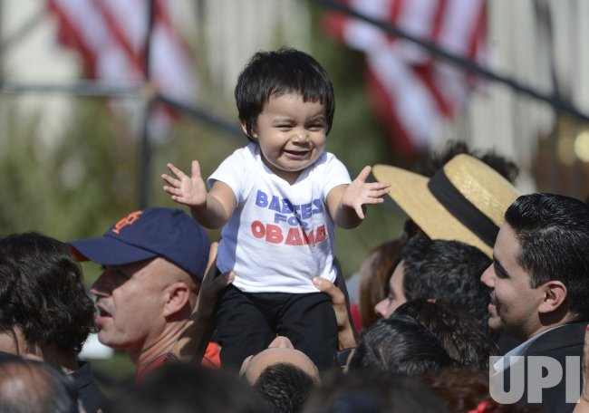 Baby held up by supporters as President Barack Obama addresses a crowd of thousands in Keene, California