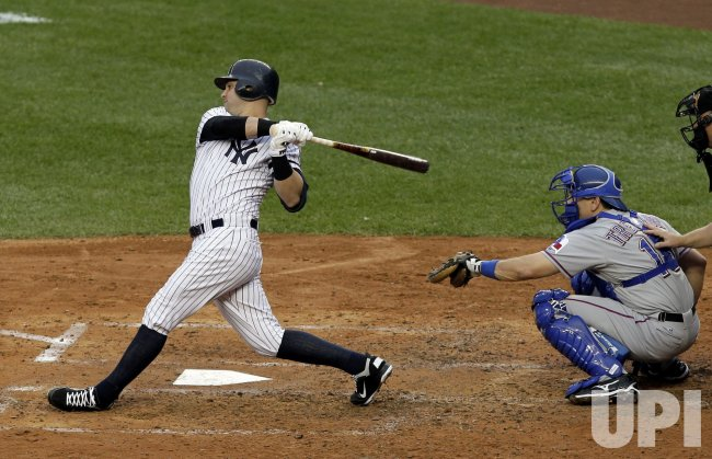 New York Yankees Nick Swisher hits a solo homer in Game 5 of the 2010 ALCS at Yankee Stadium in New York