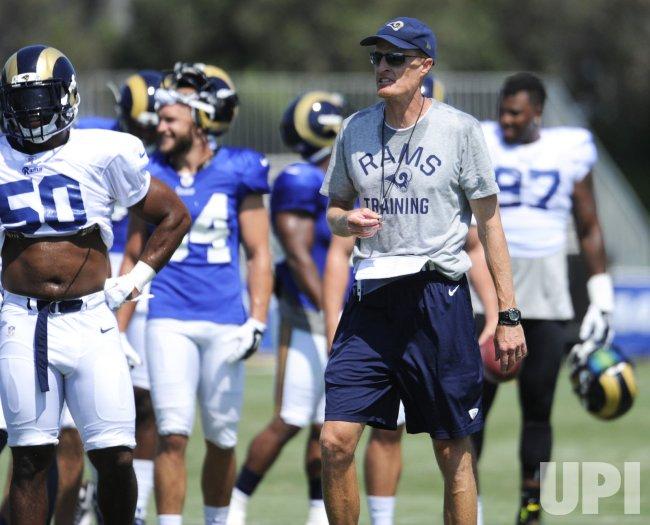 4f60e80b Rams' coach John Fassel watches team during training camp at UC ...