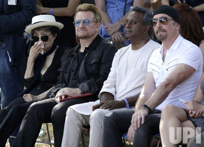 U2 unveil a tapestry honoring John Lennon in the presence of Yoko Ono
