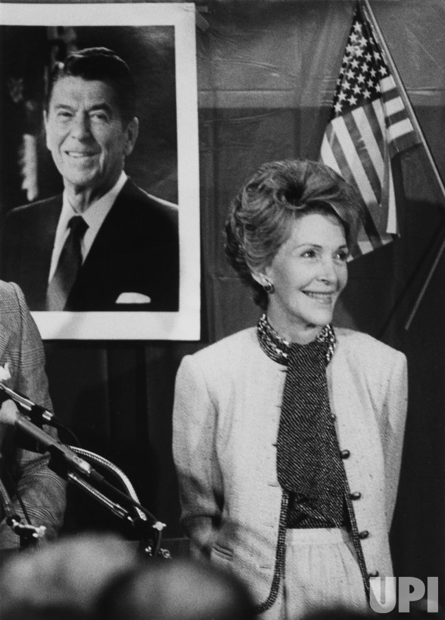 Nancy Reagan Beside Portrait of President Reagan