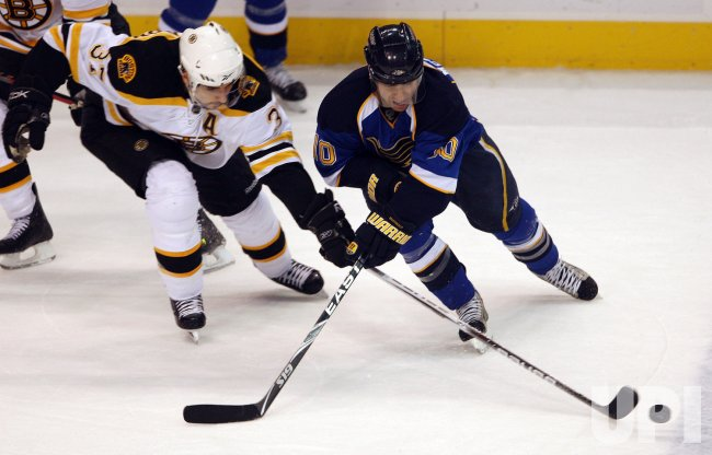 Boston Bruins Patrice Bergeron and St. Louis Blues Andy McDonald