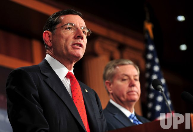Sen. Lindsey Graham and Sen. John Barrasso speak on repealing the health care law in Washington