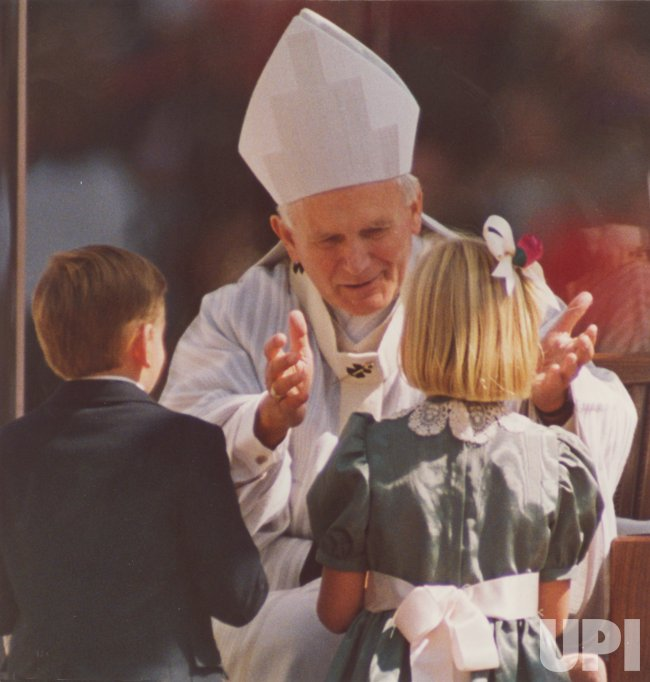 Pope John Paul II greets children