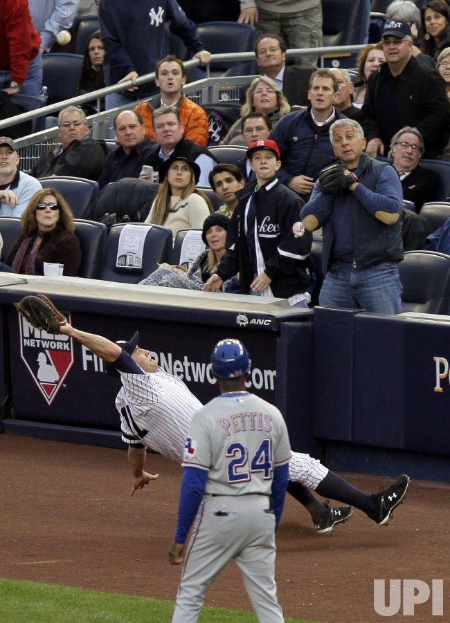 New York Yankees Lance Berkman slips and falls on his back trying to catch a foul ball in Game 5 of the 2010 ALCS at Yankee Stadium in New York