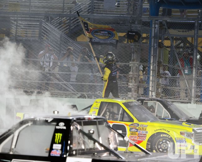 wins the 2014 NASCAR Camping World Truck Series Race at the Homestead-Miami Speedway in Homestead, Florida