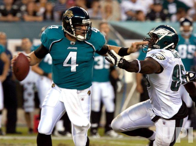 Jaguars Quarterback Bouman Dodges A Tackle
