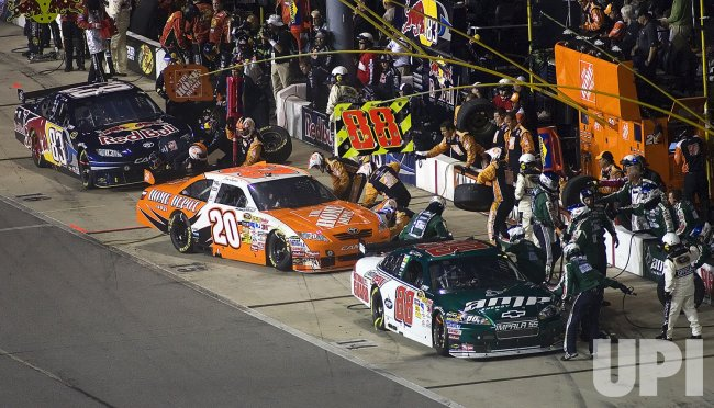 Dale Earnhardt Jr., Joey Logano, and Brian Vickers make pit stops during the running of theNASCAR Chevy Rock & Role 400 at Richmond International Speedway in Richmond, Virginia