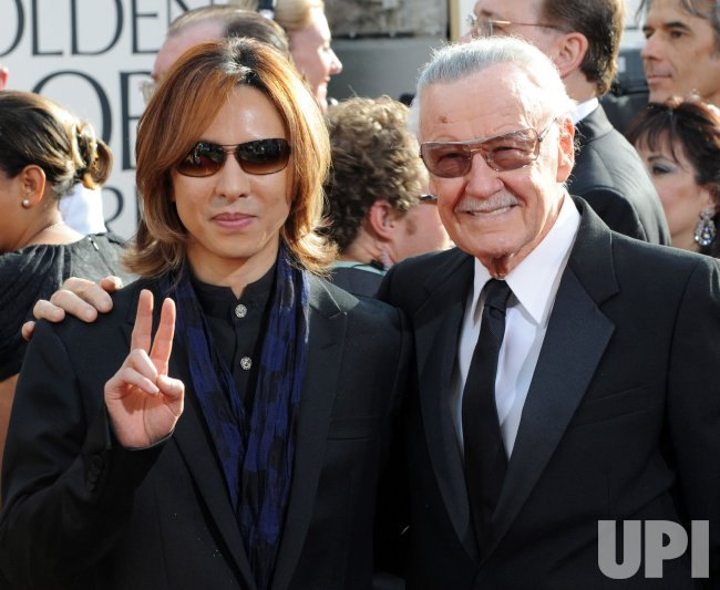 Yoshiki Hayashi and Stan Lee arrive at the 68th annual Golden Globe Awards in Beverly Hills, California