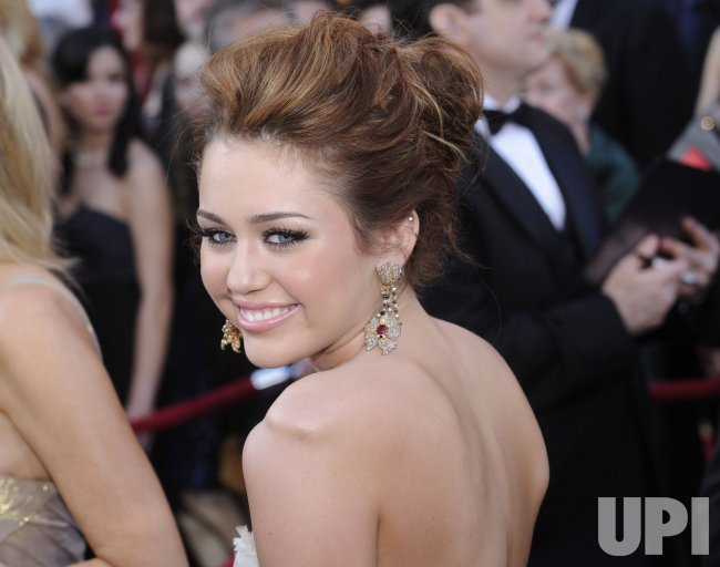 Miley Cyrus arrives at the Academy Awards in Hollywood