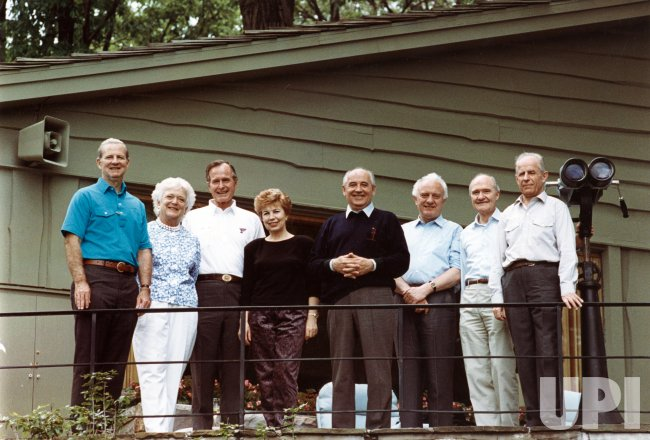 US and Soviet leaders pose for a photo with Presidents Gorbachev and Bush at Camp David