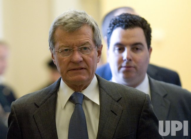 Sen. Max Baucus (D-MT) arrives for a Democratic Caucus meeting in Washington
