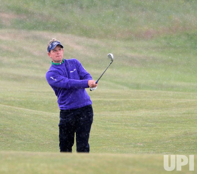 Luke Donald plays a fairway shot off on the 8th hole during the Open Championship in England