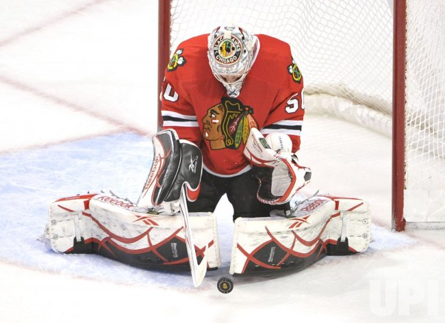 Blackhawks Crawford makes save against Red Wings in Chicago
