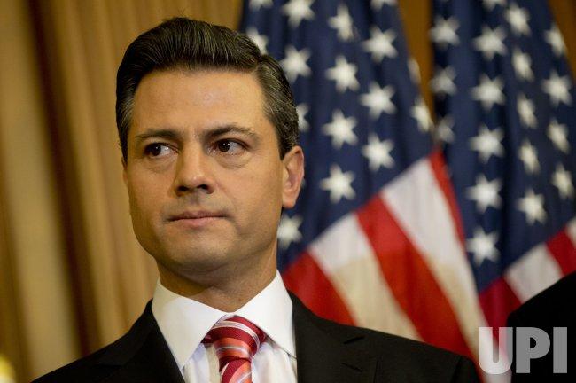 Mexican President-elect Enrique Pena Nieto meets with House Minority Leader Pelosi in Washington