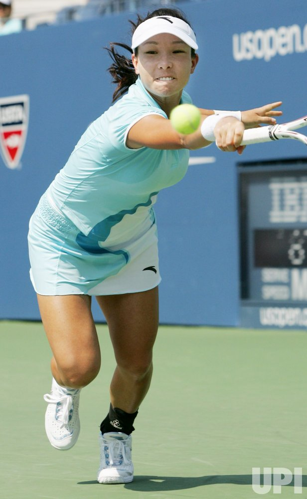Ana Ivanovic and Jie Zheng of China compete at the U.S. Open in New York