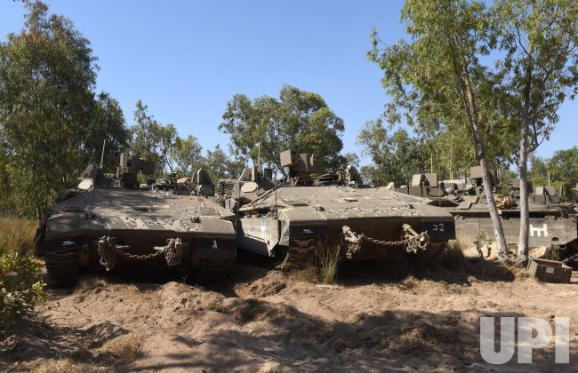 Israeli Armoured Personnel Carriers Set In A Staging Area On The Israel-Gaza Border