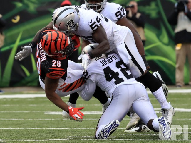 Bengals Joe Mixon ackled by Raiders Tahir Whitehead