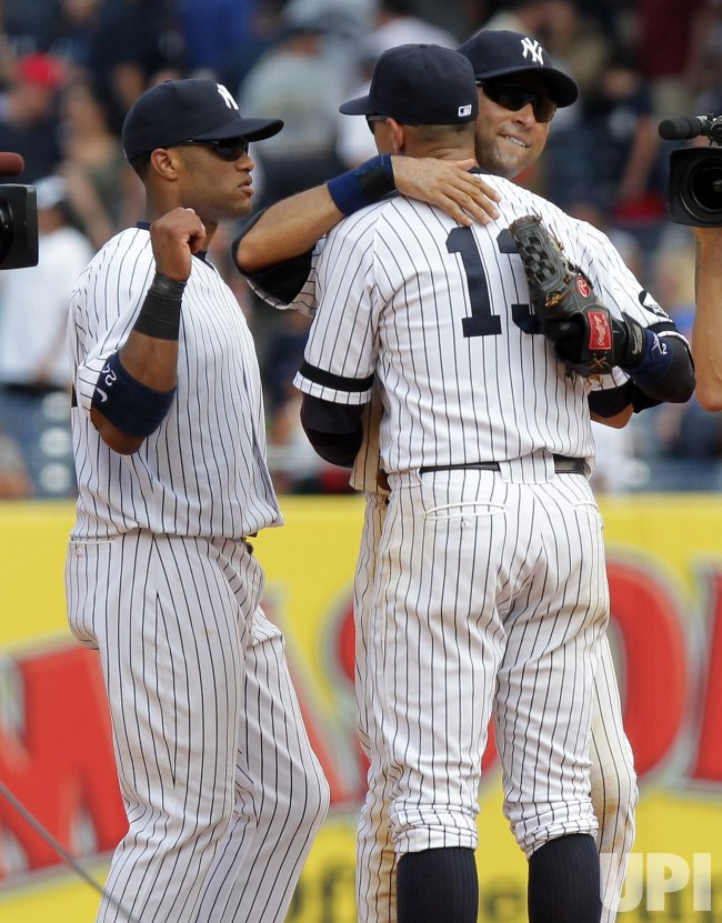 New York Yankees Robinson Cano, Derek Jeter and Alex Rodriguez react after the game at Yankee Stadium in New York
