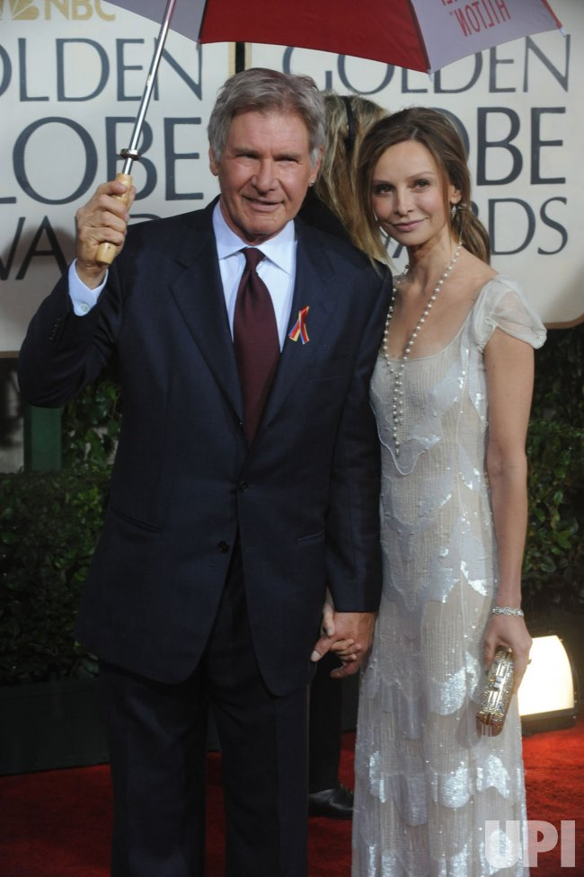 Harrison Ford and Calista Flockhart arrive at the 67th annual Golden Globe Awards