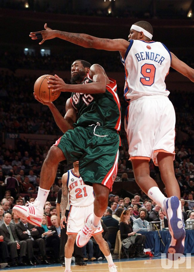 Milwaukee Bucks John Salmons leaps under New York Knicks Jonathan Bender at Madison Square Garden