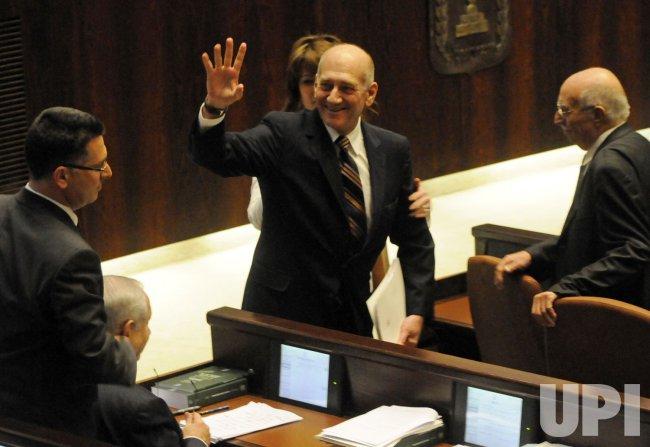 Israeli Prime Minister Ehud Olmert waves in the Knesset in Jerusalem