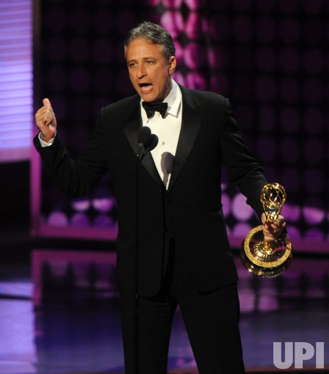 Jon Stewart accepts an award at the 61st Primetime Emmy Awards in Los Angeles