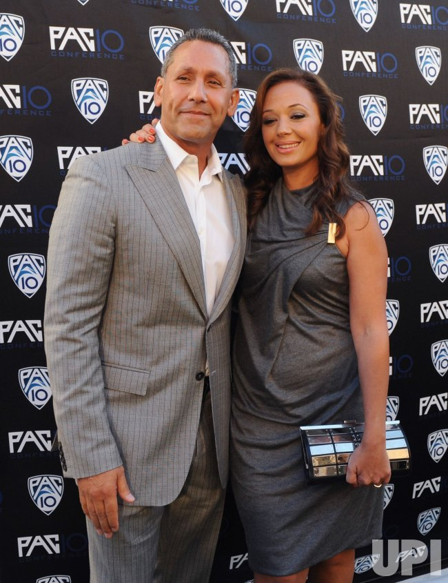 Angelo Pagan and Leah Remini attend FOX Sports/PAC-10 Conference Hollywood premiere night in Los Angeles