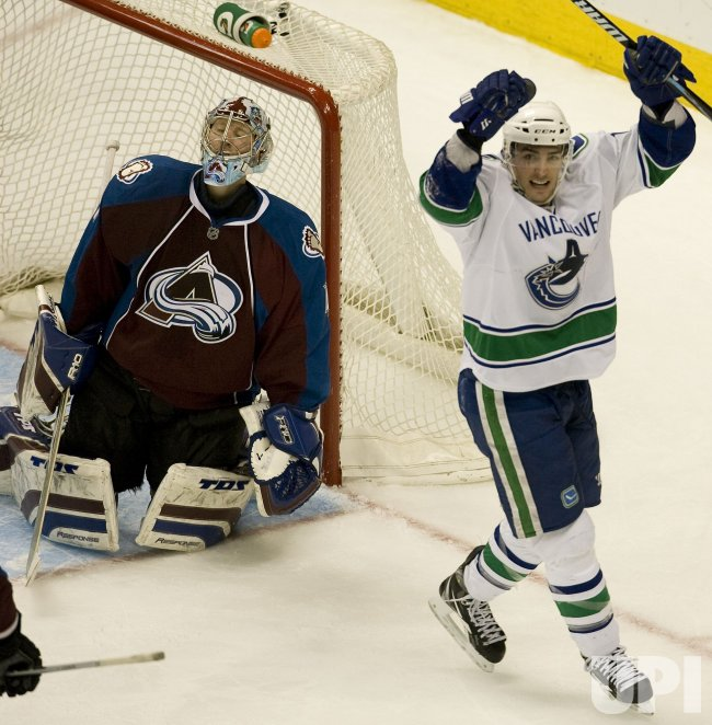 Avalanche Goalie Anderson Reacts as Canucks Burrows Celebrates in Denver