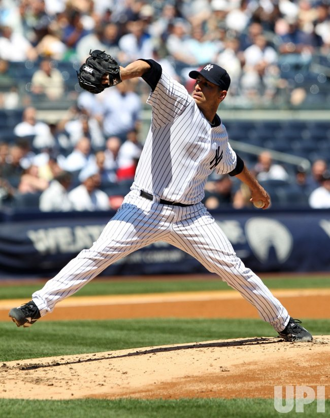 New York Yankees starting pitcher Andy Pettitte throws a first inning pitch at Yankee Stadium in New York