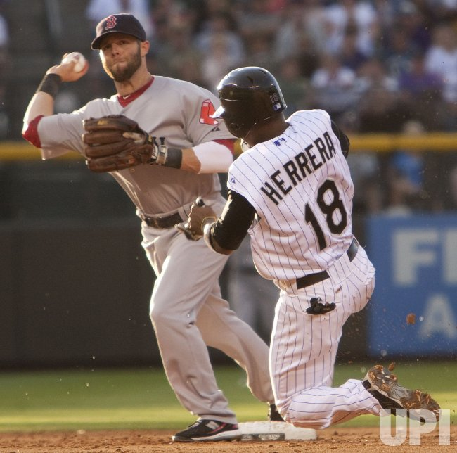 Red Sox Pedroia Starts Double Play over Rockies Herrera in Denver