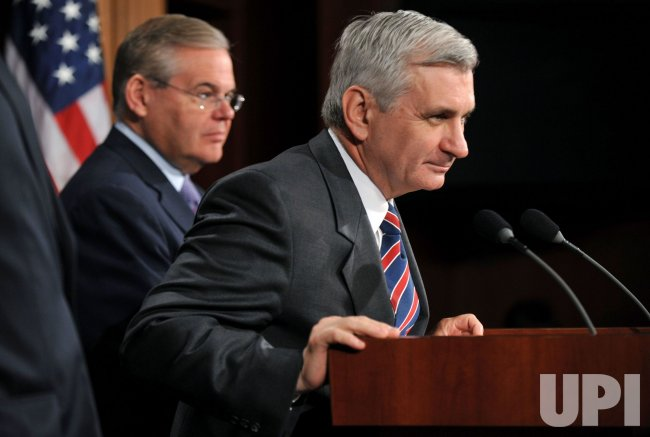 Sen. Jack Reed (D-RI) (R) and Sen. Robert Menendez (D-NJ) speak on the financial reform bill in Washington
