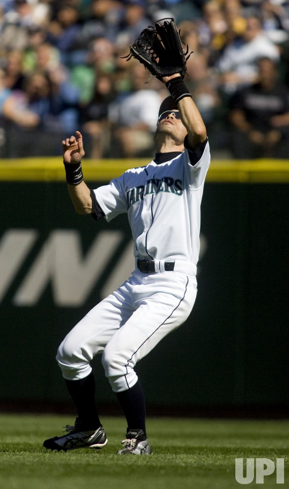 Seattle Mariners right field Ichiro Suzuki catches a fly ball hit by New York Yankees' Alex Rodriquez .
