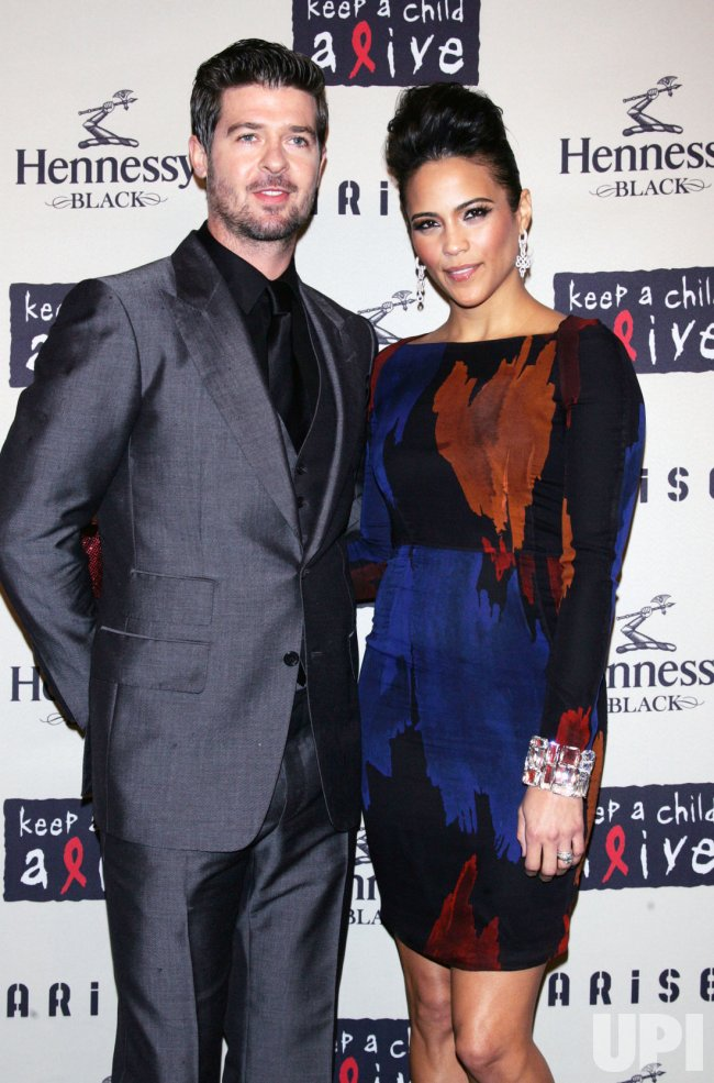 Paula Patton and husband Robin Thicke arrive at the Keep a Child Alive's 6th Annual Black Ball in New York