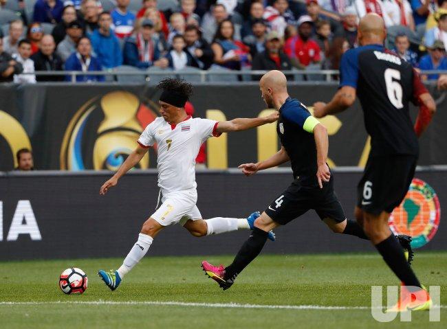 Costa Rica's Bolanos kicks as United States defends during Copa America Centario in Chicago
