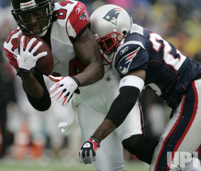 Atlanta Falcons' Roddy White is tackled by New England Patriots' Leigh Bodden at Gillette Stadium