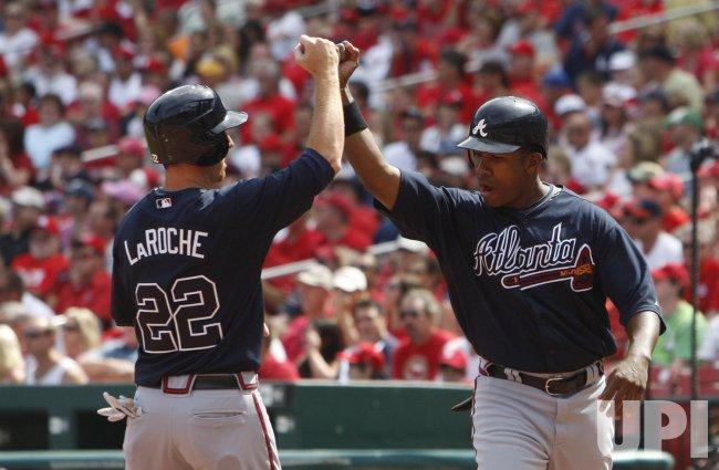 Atlanta Braves Garrett Anderson and Adam LaRoche celebrate in St. Louis