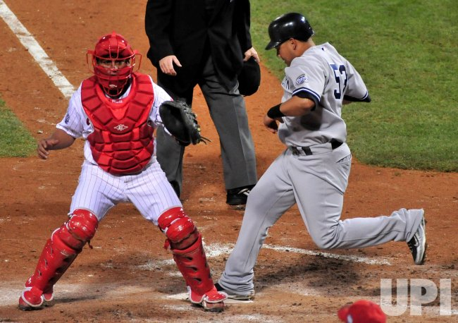 Yankees' Melky Cabrera scores during game 3 of the world series in Philadelphia