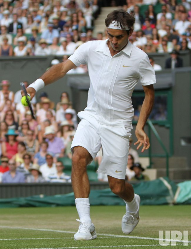 Roger Federer plays against Frenchman Arnaud Clement at the Wimbledon Championships