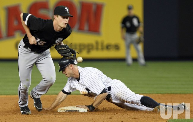 New York Yankees Brett Gardner steals second at Yankee Stadium in New York