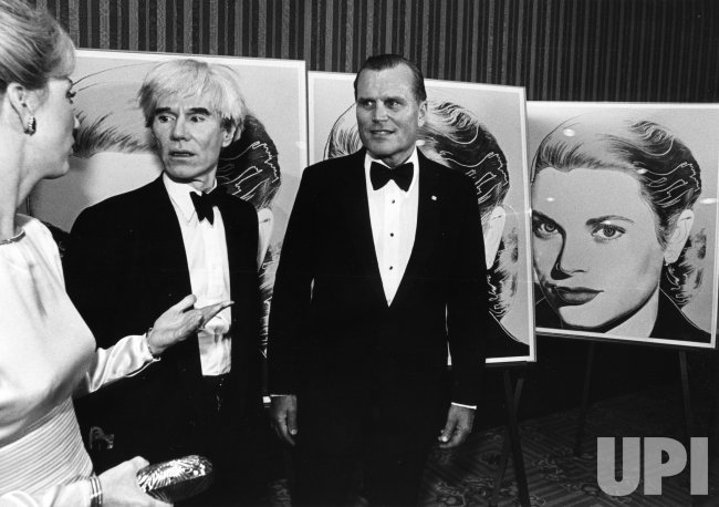 Andy Warhol, Jack Kelly and wife, in front of a Warhol Serrgraph of Princess Grace