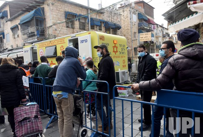 People Wait In Line To Receive The Pfizer-Biotech Coronavirus Vaccine In Jerusalem
