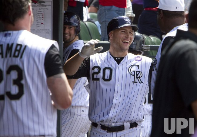 Rockies Iannetta Smiles After Solo Home Run Against the Giants in Denver