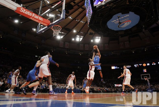Oklahoma City Thunder Russell Westbrook shoots a jump shot over New York Knicks Wilson Chandler at Madison Square Garden in New York