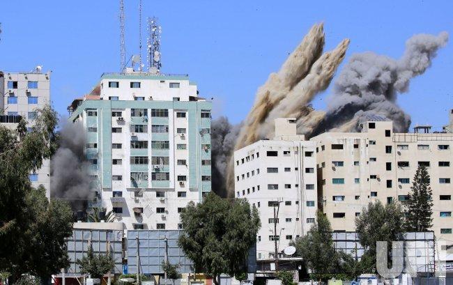 An Israeli Air Strike Demolished Building Housing World Press Offices in Gaza