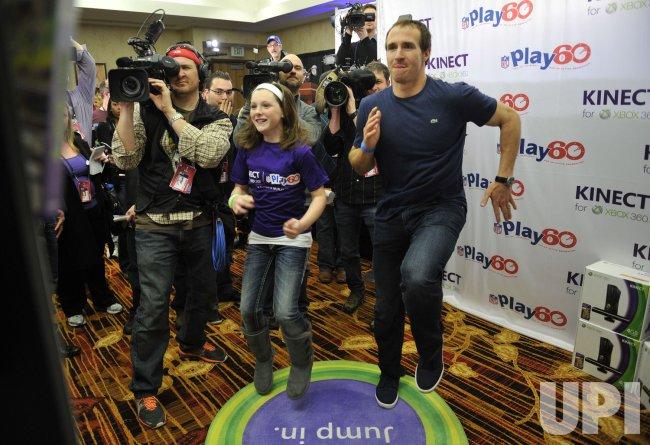 Saints quarterback Drew Breese plays XBox Kinect in Indianapolis