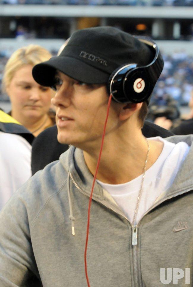 Musician Eminem visits Cowboys Stadium.