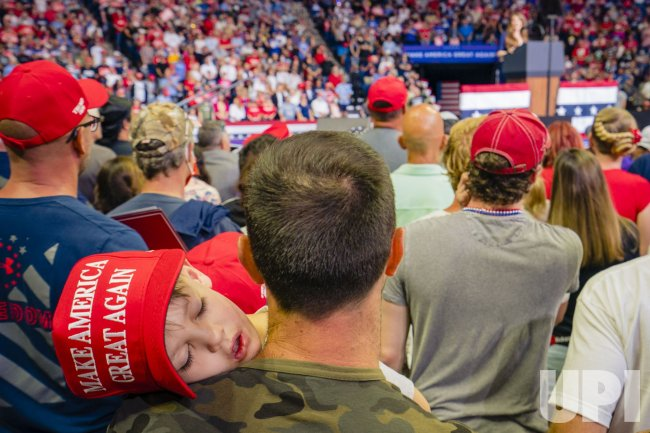 A Child Sleeps while Attending a President Trump Rally